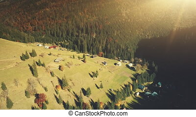 Sunny mountainous cottage village aerial view - Sunny...