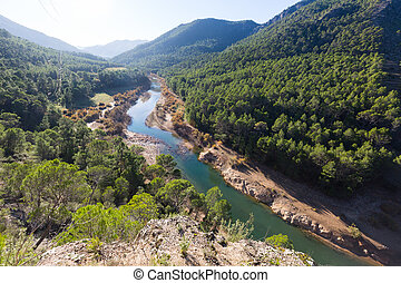 Sunny mountains landscape with river. Guadalquivir river, ...