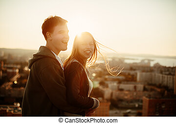 Man and woman laughing and having fun