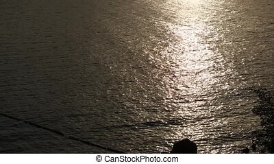 Sunny path of sunset on the water. Adriatic sea, Montenegro.