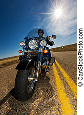 Sunny ride - A biker enjoying a ride in the country side on...