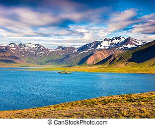 Sunny sammer morning in the Icelandic fjords.