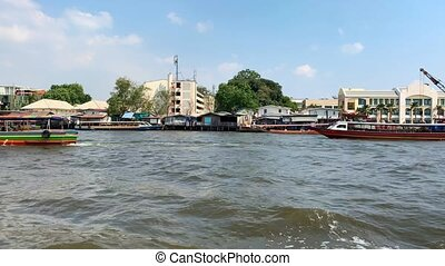 Sunny seafront of Bangkok with few colorful boats - Few...