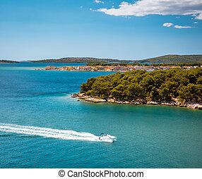 Sunny shore of the Adriatic sea near Brodarica coastline, Croatia