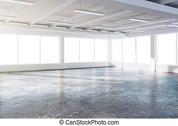 Sunny spacious hangar area with concrete floor and windows...