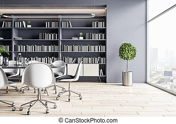 Sunny spacious office hall with white chairs around conference table on big library bookcase background and city view from huge window