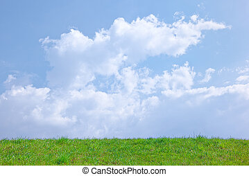 Sunny spring background with clouds on the blue sky