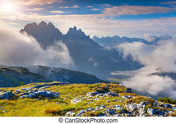 Sunny summer morning in the Italian Alps. Dolomites mountains, I