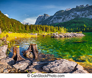 Sunny summer morning on the Vorderer Gosausee lake in the Austrian Alps