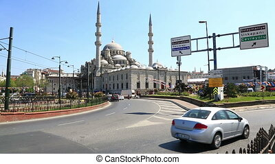 Cars passing by the Yeni Cami (New Mosque), originally the Valide Sultan Mosque building in sunny spring day