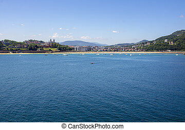 sunny view of the beautiful bay of San Sebastian, Spain