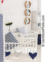 Sunny wake-up in a cosy baby bed
