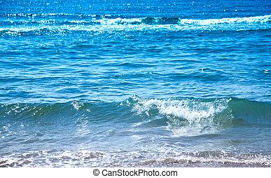 Sunny waves on the sea.
