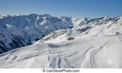Sunny Winter Day in Snowy Alps Mountains in Solden Valley...