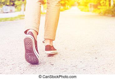 woman legs gumshoes - sunny woman legs gumshoes walk