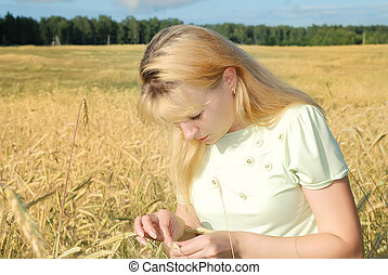Sunny young beauty girl the field under blue sky 4