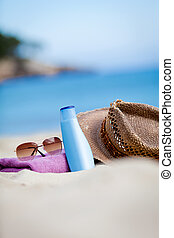 sunprotection objects on the beach in holiday sunglasses hat suncare