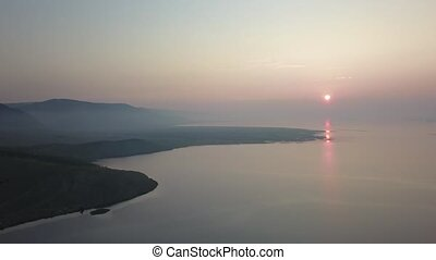 Sunrise about lake Baikal in the summer from drone - View ...