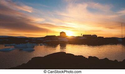 Sunrise above Academic Vernadsky Research Station -...