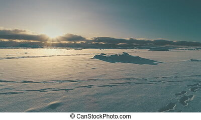 Sunrise above arctic snow covered surface top view - Sunrise...