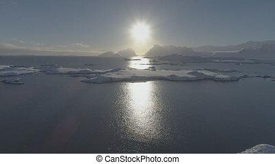 Sunrise above arctic snow mountain aerial top view - Sunrise...