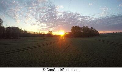 Sunrise above fields, time lapse 4K