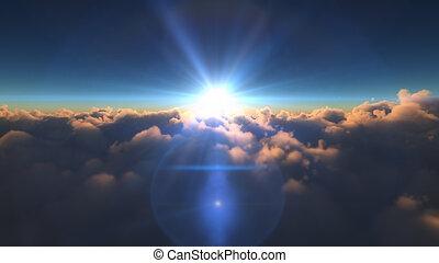 sunrise above in clouds