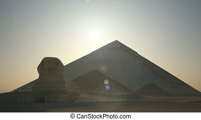 Sunrise above pyramids and sphinx