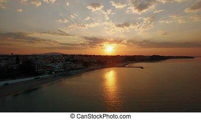 Sunrise aerial panorama of coastal resort town. Nea...