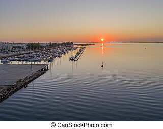 Sunrise aerial seascape view of Olhao Marina, waterfront to ...