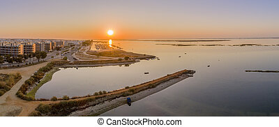 Sunrise aerial seascape view of Olhao salt marsh Inlet,...