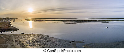 Sunrise aerial seascape view of Olhao salt marsh Inlet,...