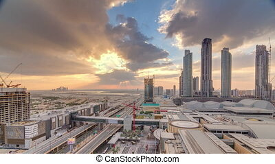 Sunrise aerial view of Financial center road morning timelapse with under construction building