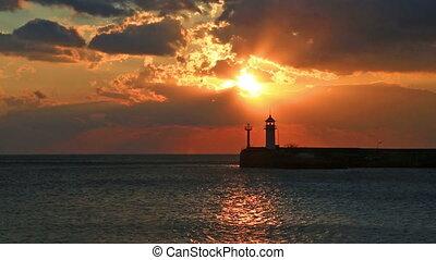 Sunrise against a beacon in Yalta, the Crimea