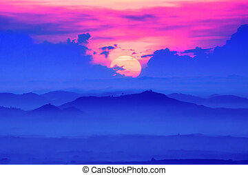 Sunrise and blue mountain with mist.