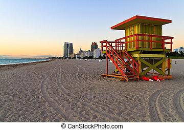 Sunrise and cabin on the beach, Miami Beach, Florida, USA -...