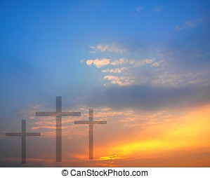 Sunrise and Easter Theme - Three crosses against a beautiful...