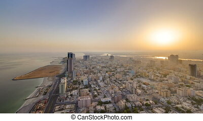 Sunrise and morning with Cityscape of Ajman from rooftop...