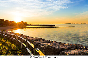 Sunrise at a scenic beach - The sunrises on a scenic beach...