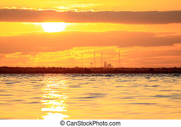 sunrise at a space shuttle launch pad