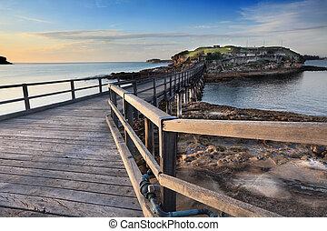 Sunrise at Bare Island Australia. The island is accessible ...