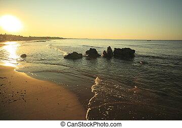 sunrise at coast of the sea