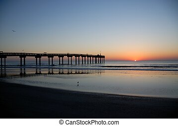 sunrise at fishing pier st. augustine beach florida usa
