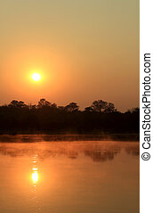 Sunrise at Kavango river whit mist on the water surface
