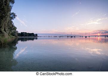 Sunrise at lake with sailboats 3