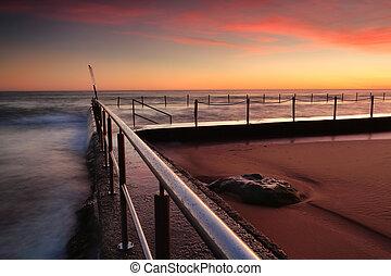 Sunrise at Newport beach rock pool Australia