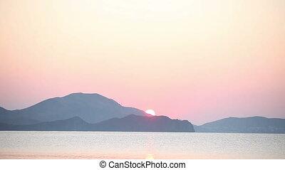 Sunrise at sea beach and mountains