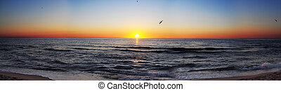 Sunrise at sea panorama - Panorama shot of sun rising over...