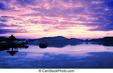 Sunrise at Sun Moon Lake in Taiwan - The day breaks at the...