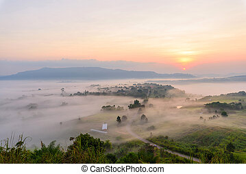 sunrise at the mountain with the mist